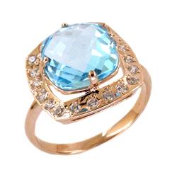 Золотое кольцо с крупным топазом и фианитами