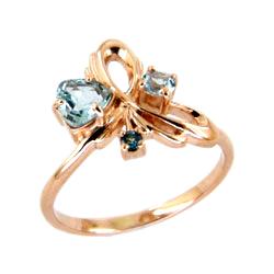 Кольцо из золота с топазами и синим фианитом