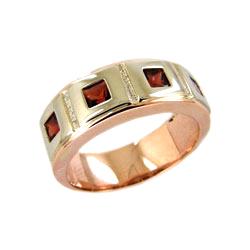 Кольцо из красного и белого золота с гранатами