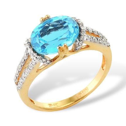 Кольцо из золота с крупным топазом и фианитами