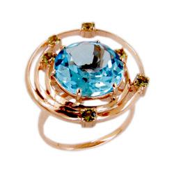 Кольцо из золота с топазом и хризолитами